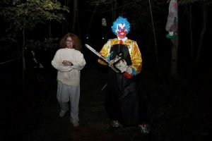clown with chainsaw and victim