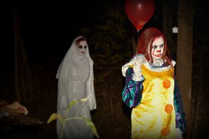 Pennywise the Clown Followed by White Witch