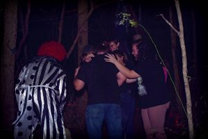 Crowd Huddled to Hide from Killer Clown