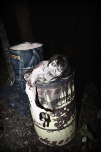 Screaming Dead Man in Barrel